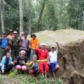 Villagers and visitors posing in front of a megalith found in Long Semadoh called Batuh Inarit.  Photo credit: © WWF-Malaysia/Zora Chan